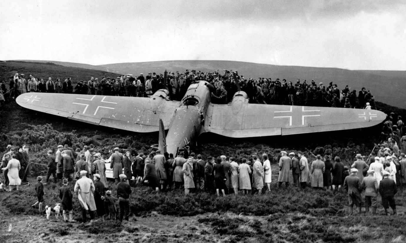 A World War 2 German bomber plane that crashed near Edinburgh during the war. The plane is surround by a crowd of interested locals.