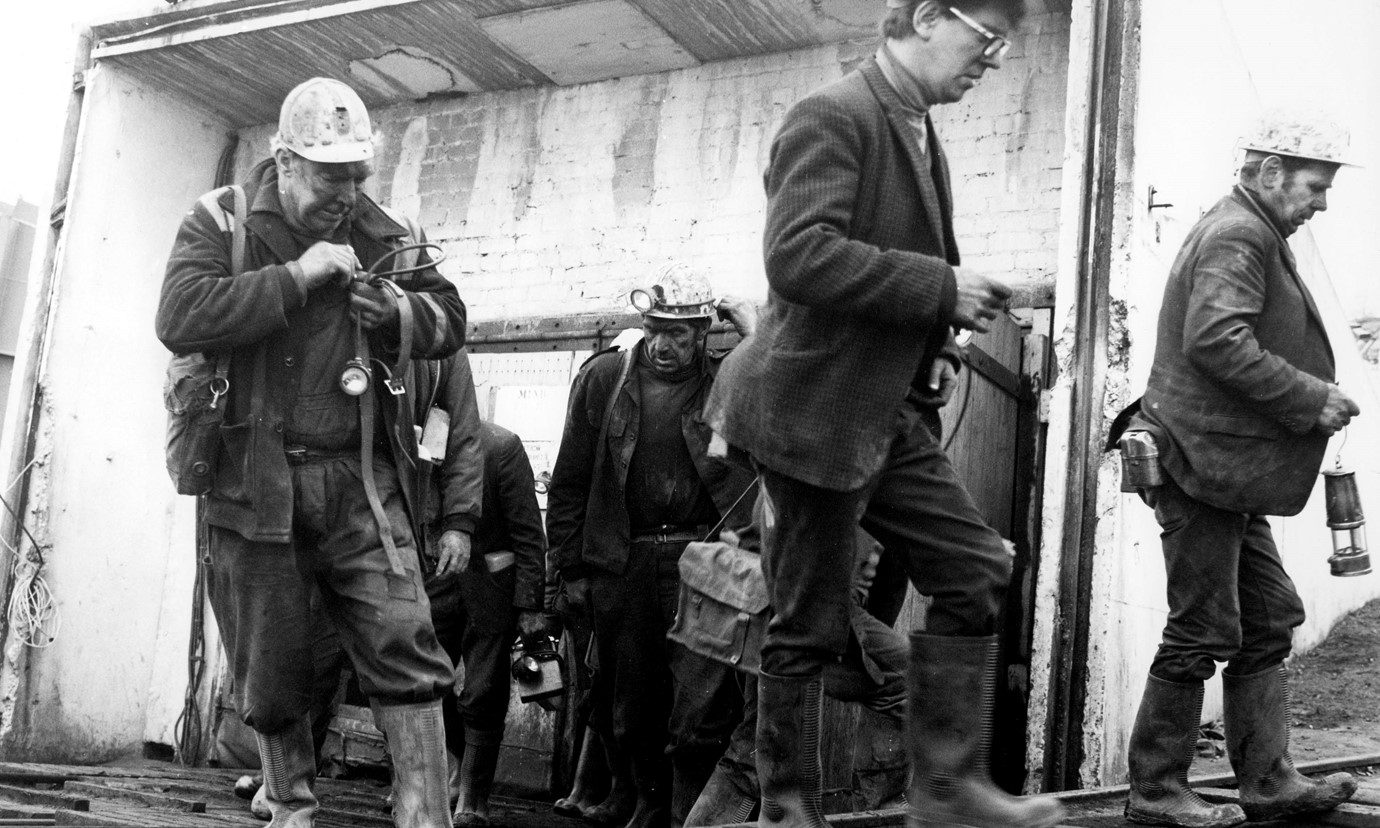 A group of miners leaving the mine after their shift.